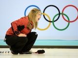 Canadian Jennifer Jones reacts as she throws the stone during the 2014 Sochi winter Olympics women's curling round robin session 4 match against Great Britain at the Ice Cube curling centre in Sochi on February 12, 2014