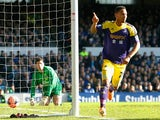Swansea's Jonathan de Guzman celebrates after scoring his team's opening goal against Everton in their FA Cup fifth round match on February 9, 2014