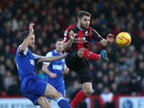 Josh McQuoid of Bournemouth beats Cole Skuse of Ipswich to the ball during the Sky Bet Championship match between AFC Bournemouh and Ipswich Town at The Goldsands Stadium on December 29, 2013