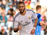 Real's Karim Benzema celebrates after scoring his team's second goal against Getafe during their La Liga match on February 16, 2014