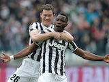 Juventus' Kwadwo Asamoah celebrates with teammate Stephan Lichtsteiner after scoring the opening goal against Chievo Verona during their Serie A match on February 16, 2014