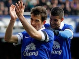 Everton's Leighton Baines celebrates with teammate Kevin Miralla after scoring his team's third goal via the penalty spot against Swansea during their FA Cup fifth round match on February 9, 2014