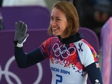 Lizzy Yarnold of Great Britain waves after her run during the Women's Skeleton heats on Day 6 of the Sochi 2014 Winter Olympics at Sliding Center Sanki on February 13, 2014