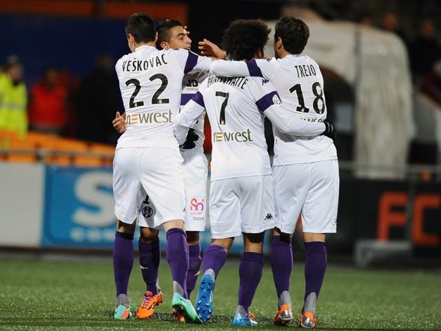 Toulouse's French forward Wissam Ben Yedder celebrates after scoring a goal with his teammates during the French L1 football match between Lorient and Toulouse on February 15, 2014
