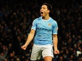 Samir Nasri of Manchester City celebrates scoring during the FA Cup Fifth Round match between Manchester City and Chelsea at the Etihad Stadium on February 15, 2014