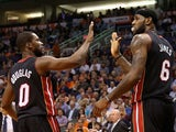 LeBron James #6 of the Miami Heat high fives Toney Douglas #0 after scoring against the Phoenix Suns during the second half of the NBA game at US Airways Center on February 11, 2014