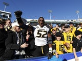 Michael Sam #52 of the Missouri Tigers celebrates with fans after the game against the Kentucky Wildcats at Commonwealth Stadium on November 9, 2013