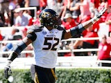 Michael Sam #52 of the Missouri Tigers recovers a fumble for a touchdown against the Georgia Bulldogs at Sanford Stadium on October 12, 2013