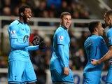 Emmanuel Adebayor of Tottenham Hotspur celebrates scoring the opening goal with team mates during the Barclays Premier League match between Newcastle United and Tottenham Hotspur at St James' Park on February 12, 2014
