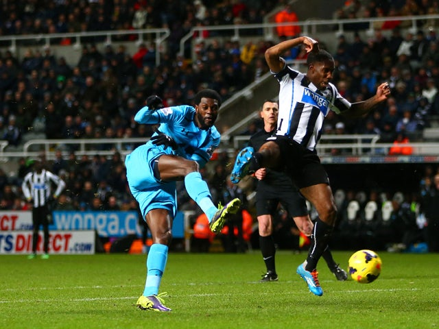 Emmanuel Adebayor of Tottenham Hotspur scores their third goal during the Barclays Premier League match between Newcastle United and Tottenham Hotspur at St James' Park on February 12, 2014