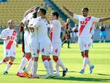 Melbourne Heart's Orlando Engelaar is congratulated by teammates after scoring his team's opening goal against Wellington Phoenix in their A-League match on February 16, 2014