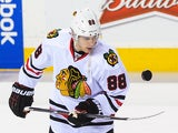 Patrick Kane of the Chicago Blackhawks juggles the puck during warm-ups prior to an NHL game against the Calgary Flames at Scotiabank Saddledome on January 28, 2014