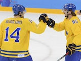 Sweden's Patrik Berglund (L) celebrates with his teammate Sweden's Erik Karlsson after scoring a goal during the Men's Ice Hockey Group C match against Latvia on February 15, 2014