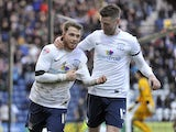 Joe Garner of Preston North End celebrates with team-mate Jake Larkins after he scores the first goal of the game for his side from the penalty spot during the Sky Bet League One match between Preston North End and Leyton Orient at Deepdale on February 15
