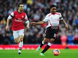 Liverpool's Raheem Sterling and Arsenal's Mathieu Flamini in action during their FA Cup fifth round match on February 9, 2014