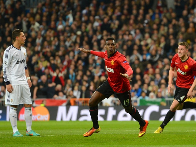 Danny Welbeck of Manchester United celebrates scoring the opening goal during the UEFA Champions League Round of 16 first leg match between Real Madrid and Manchester United at Estadio Santiago Bernabeu on February 13, 2013