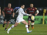 Ryan Lamb of Leicester kicks the ball upfield during the Aviva Premiership match between Saracens and Leicester Tigers at Allianz Park on December 21, 2013