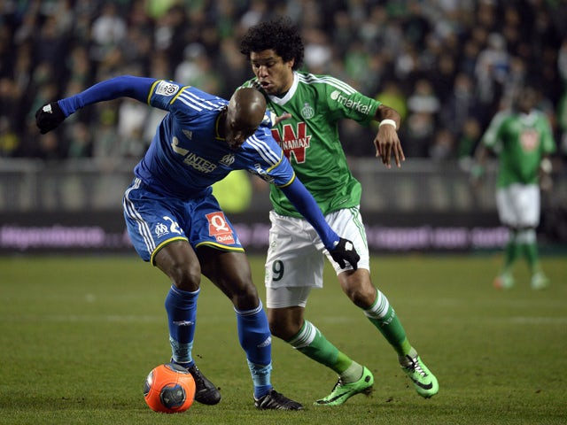 Marseille's Senegalese defender Souleymane Diawara vies for the ball with Saint-Etienne's Brazilian forward Brandao during the French L1 football match between Saint-Etienne and Marseille, at the Geoffroy Guichard stadium in Saint-Etienne, central France,