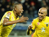 Sochaux's Zambian defender Stoppila Sunzu jubilates after scoring a goal during the French L1 football match between Sochaux (FCSM) and Guingamp (EAG) on February 15, 2014