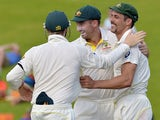 Australian cricketer Mitchell Johnson celebrates with teammates after catching out South Africa's cricketer JP Duminy (unseen) for 25 runs during the second day of the first test match between South Africa and Australia at SuperSport Park in Centurion on