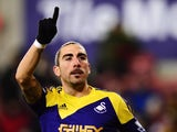 Chico Flores of Swansea City celebrates scoring during the Barclays Premier League match between Stoke City and Swansea City at the Britannia Stadium on February 12, 2014