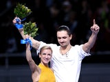 Gold medalists Tatiana Volosozhar and Maxim Trankov of Russia on the podium during the flower ceremony for the Figure Skating Pairs event during day five of the 2014 Sochi Olympics at Iceberg Skating Palace on February 12, 2014
