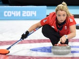 Great Britain's Anna Sloan trows the stone during the 2014 Sochi winter olympics women's curling round robin session 3 match against the US at the Ice Cube curling centre in Sochi on February 11, 2014