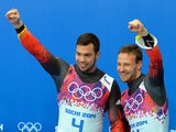 Gold Medallists, Germany's Tobias Arlt and Tobias Wendl celebrate at the Luge Doubles Flower Ceremony at the Sanki Sliding Center during the Sochi Winter Olympics on February 12, 2014