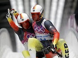 Tobias Wendl and Tobias Arlt of Germany celebrate after completing their second run during the Men's Luge Doubles on Day 5 of the Sochi 2014 Winter Olympics at Sliding Center Sanki on February 12, 2014