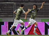 Bastia's French defender Francois Joseph Modesto celebrates with teammates after scoring a goal during the French L1 football match Toulouse against Bastia on February 11, 2014