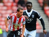 Victor Wanyama of Southampton marshalls Emanuele Giaccherini of Sunderland during the FA Cup fifth round match on February 15, 2014