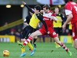 Fernando Forestieri of Watford holds off the challenge of Jonathan Woodgate of Middlesbrough during the Sky Bet Championship match between Watford and Middlesbrough at Vicarage Road on February 15, 2014