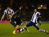 Eden Hazard of Chelsea is tackled by Morgan Amalfitano of West Brom during the Barclays Premier League match between West Bromwich Albion and Chelsea at The Hawthorns on February 11, 2014