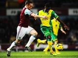 Kevin Nolan of West Ham United challenges Alexander Tettey of Norwich City during the Barclays Premier League match between West Ham United and Norwich City at the Boleyn Ground on February 11, 2014