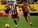 Zeli Ismail of Wolves battles with Sam Saunders of Brentford during the Sky Bet League One game between Wolverhampton Wanderers and Brentford at Molineux on November 23, 2013