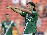 Newcastle Jets'  Zenon Caravella celebrates victory over Brisbane in their A-League match on February 16, 2014