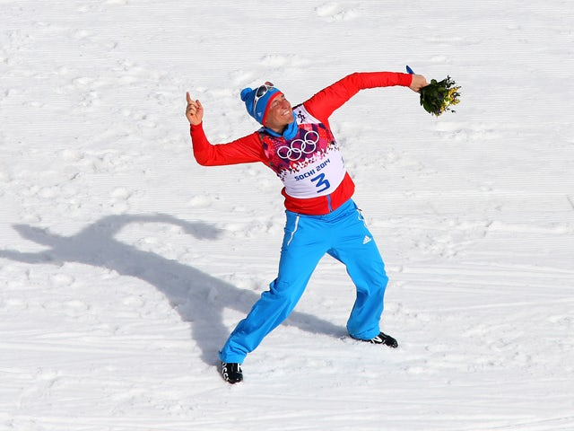 Gold medalist Alexander Legkov of Russia celebrates during the flower ceremony for the Men's 50 km Mass Start Free during day 16 of the Sochi 2014 Winter Olympics at Laura Cross-country Ski & Biathlon Center on February 23, 2014