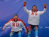 Gold Medallist, Russia-1 pilot Alexander Zubkov and brakeman Alexey Voevoda celebrate during the Bobsleigh Two-man Flower Ceremony at the Sliding Center Sanki during the Sochi Winter Olympics on February 17, 2014