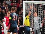 Arsenal's Polish goalkeeper Wojciech Szczesny is given the red card after a foul on Bayern Munich's Dutch midfielder Arjen Robben during the UEFA Champions League Last 16, first leg football match between Arsenal and Bayern Munich at The Emirates Stadium