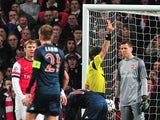 Arsenal's Polish goalkeeper Wojciech Szczesny is given the red card after a foul on Bayern Munich's Dutch midfielder Arjen Robben during the UEFA Champions League Last 16, first leg football match between Arsenal and Bayern Munich at The Emirates Stadium
