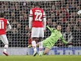 Bayern Munich's goalkeeper Manuel Neuer saves a penalty kick from Arsenal's German midfielder Mesut Ozil during the UEFA Champions League Last 16, first leg football match between Arsenal and Bayern Munich at The Emirates Stadium in north London on Februa