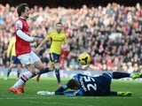 Tomas Rosicky of Arsenal lifts the ball over Vito Mannone of Sunderland to score a goal during the Barclays Premier League match between Arsenal and Sunderland at Emirates Stadium on February 22, 2014