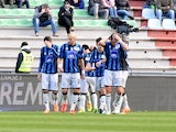 Davide Brivio of Atalanta BC is mobbed by team mates after scoring his opening goal during the Serie A match between Udinese Calcio and Atalanta BC at Stadio Friuli on February 23, 2014
