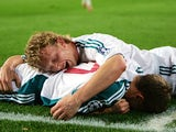 Liverpool's Craig Bellamy celebrates with Dirk Kuyt after scoring against Barcelona during the first leg of a last 16 Champions League football match at the Camp Nou stadium in Madrid, 21 February 2007