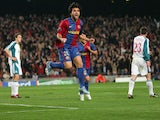 Barcelona's Deco celebrates scoring against Liverpool during the first leg of a last 16 Champions League football match at the Camp Nou stadium in Madrid, 21 February 2007