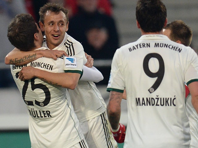 Bayern Munich's midfielder Thomas Muller and Bayern Munich's Brazilian defender Rafinha celebrate during the German first division Bundesliga football match Hannover 96 vs FC Bayern Munich on February 23, 2014