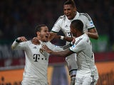 Bayern Munich's Spanish midfielder Thiago Alcantara, Bayern Munich's defender Jerome Boateng and Bayern Munich's Austrian midfielder David Alaba celebrate during the German first division Bundesliga football match Hannover 96 vs FC Bayern Munich on Februa