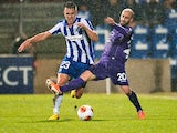 Fiorentina's Borja Valero and Esbjerg's Jonas Knudsen in action during their Europa League match on February 20, 2014