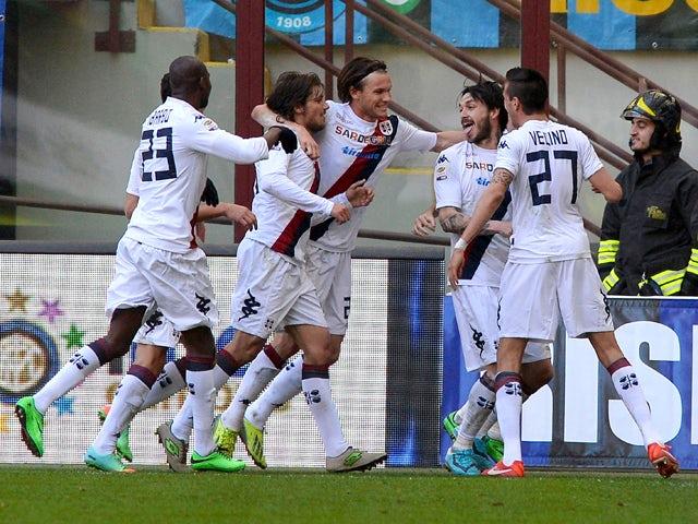 Mauricio Pinilla of Cagliari Calcio celebrates scoring the first goal during the Serie A match between FC Internazionale Milano and Cagliari Calcio at San Siro Stadium on February 23, 2014