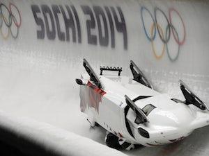 Canada-3 four-man bobsleigh, pilot Justin Kripps, pushman Jesse Lumsden, pushman Cody Sorensen and brakeman Ben Coakwell crash in the Bobsleigh Four-man Heat 2 at the Sanki Sliding Center during the Sochi Winter Olympics on February 22, 2014
